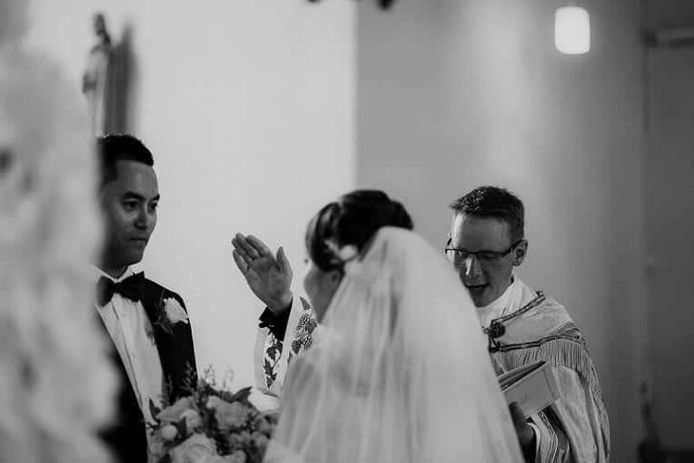 a wedding officiant performing the wedding ceremony