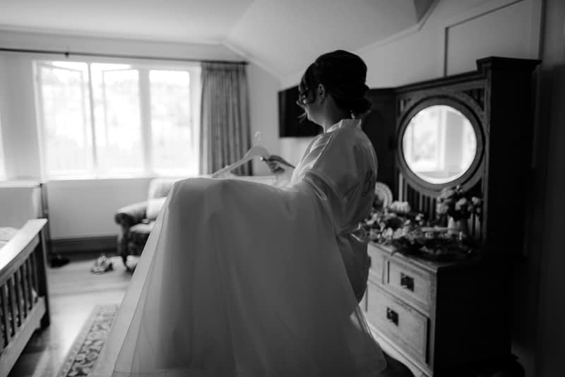 Jecca the bride with her wedding dress in black and white