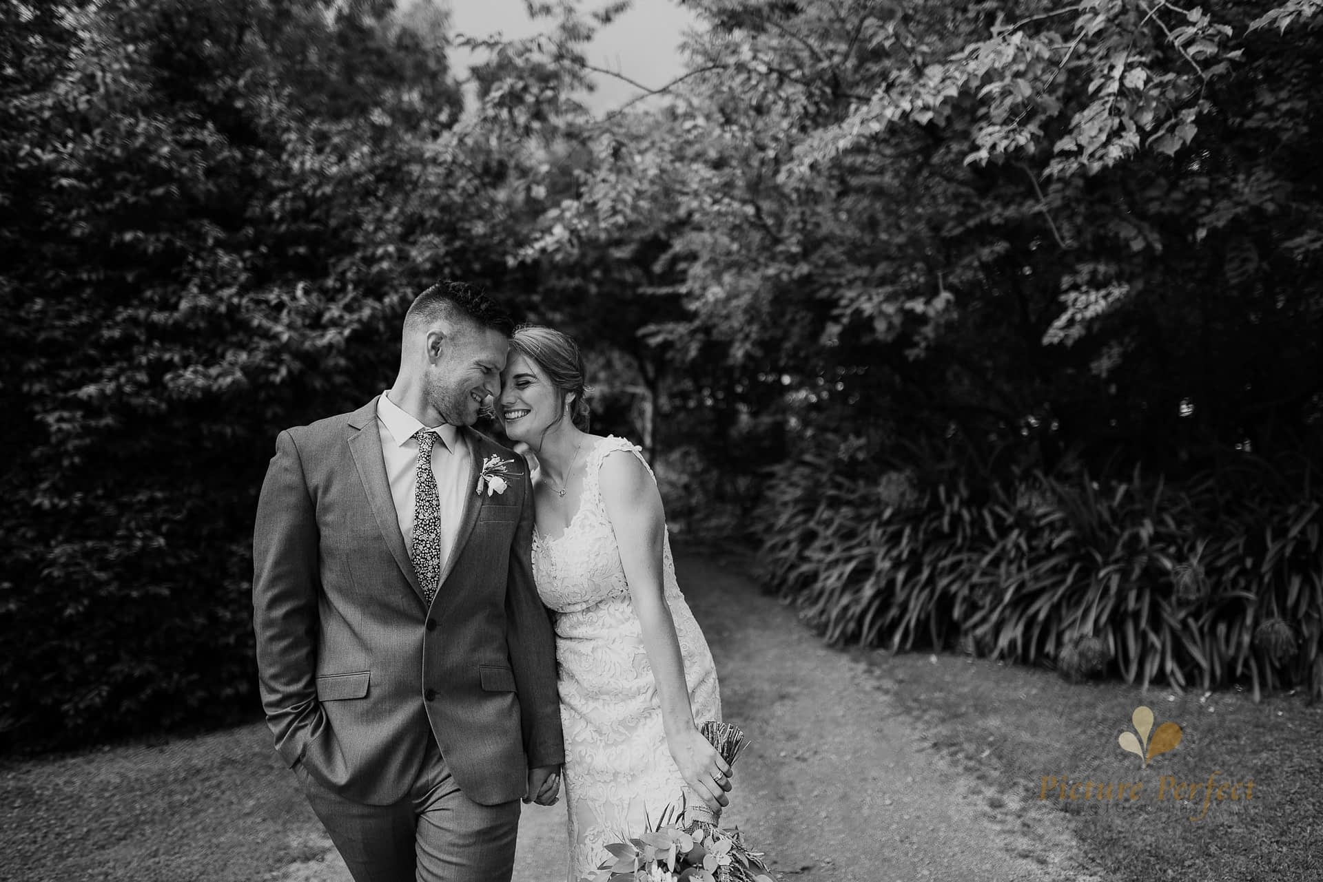 bride and groom walking and posing for their Whanganui wedding photography