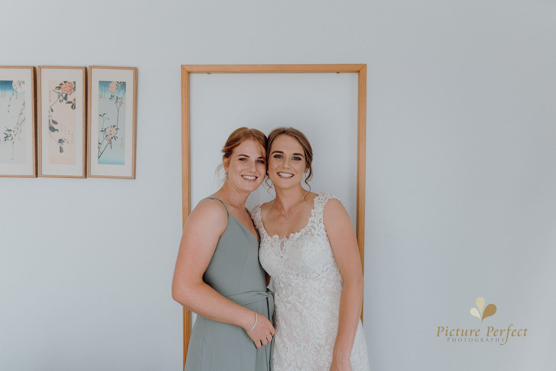 bride and her best friend during getting ready