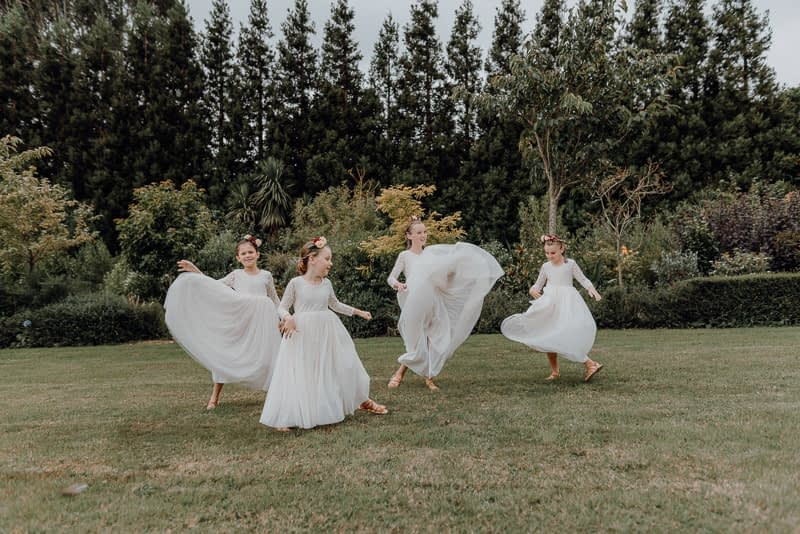 four dancing flower girls at Pohongina Heights